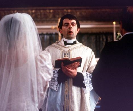 Father Gerald (Rowan Atkinson)