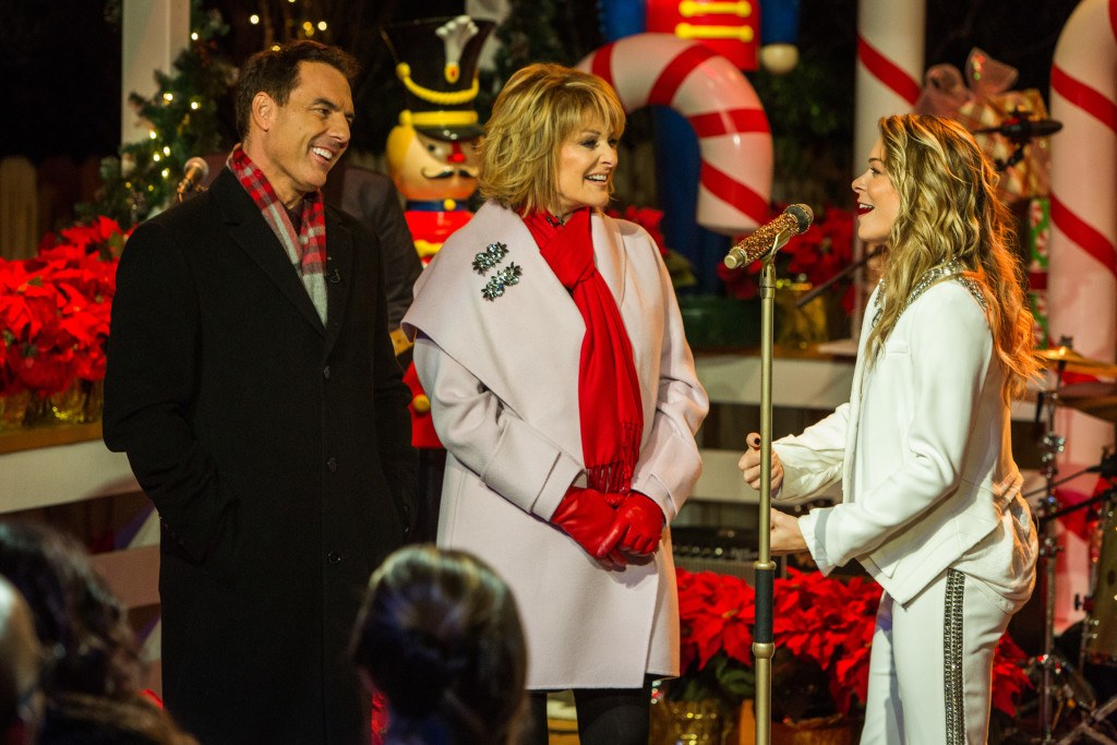 """It's our primetime, holiday special extravaganza! Mark Steines and Cristina Ferrare welcome Hallmark stars Holly Robinson Peete, Lacey Chabert, Danica McKellar, and Barbara Niven to talk about their Hallmark Channel Original Movies: """"Angel of Christmas,"""" A Christmas Melody,"""" """"Crown for Christmas,"""" and """"Christmas Detour."""" Grammy award winning musician LeAnn Rimes performs three holiday songs from her new Christmas album, """"Today Is Christmas."""" Our home is lit up to music by the Trans-Siberian Orchestra with """"Wizards in Winter"""" and """"Christmas in Sarajevo."""" Aerial Ice Extreme is here with a gravity-defying, acrobatic, ice skating performance of """"All I Want for Christmas."""" United States military band, the Six String Soldiers, perform an acoustic version of """"I'll Be Home for Christmas."""" Cristina cooks a delicious standing rib roast and Yorkshire pudding, and our Hallmark family shares their favorite holiday side dishes: Lacey Chabert's white sweet potato pie, Barbara Niven's pumpkin bars, Dan Kohler's imperial walnuts, and Dr. JJ Levenstein's brown butter spice cake. Our """"Home & Family"""" DIYers: Ken Wingard, Shirley Bovshow, Paige Hemmis, and Tanya Memme are teaming up with Hallmark stars: Lacey Chabert, Barbara Niven, Holly Robinson Peete, and Danica McKellar to make themed Christmas wreaths. Our family is sharing holiday memories and special traditions for moms and babies and fathers and sons. And, our special Santa Quartet, featuring Ken Wingard, Dan Kohler, Matt Rogers, and Matt Iseman are singing a jolly, Christmas favorite. Credit: Copyright 2015 Crown Media United States, LLC/Photographer: jeremy lee/Alexx Henry Studios, LLC"""